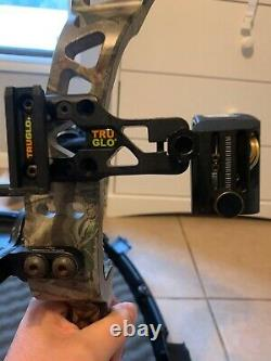 Fred Bear Instinct compound bow with True Glo 3 pin sight and stabilizer