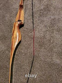 Fred Bear Tigercat Recurve 62 42# draw weight in very good condition new string