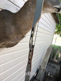 Vintage bear recurve bow